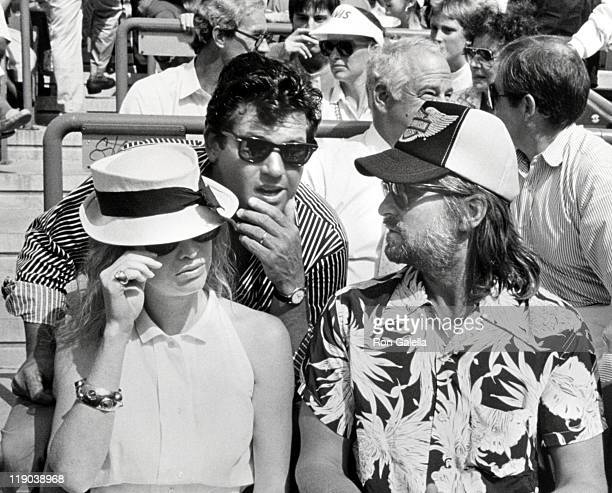 Michael Douglas, Diandra Douglas, and Jann Wenner during U.S. Tennis Open Championships- September 9, 1988 at Flushing Meadows in New York City, New...