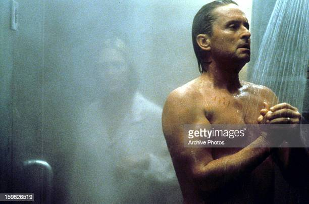 Michael Douglas in the shower in a scene from the film 'Disclosure' 1994