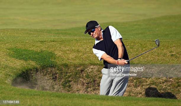 Michael Douglas plays out from a bunker during the final practice round of The Alfred Dunhill Links Championship at The Old Course on September 28,...