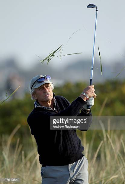 Michael Douglas plays out from the rough on the second hole during the second round of The Alfred Dunhill Links Championship at the Carnoustie Golf...
