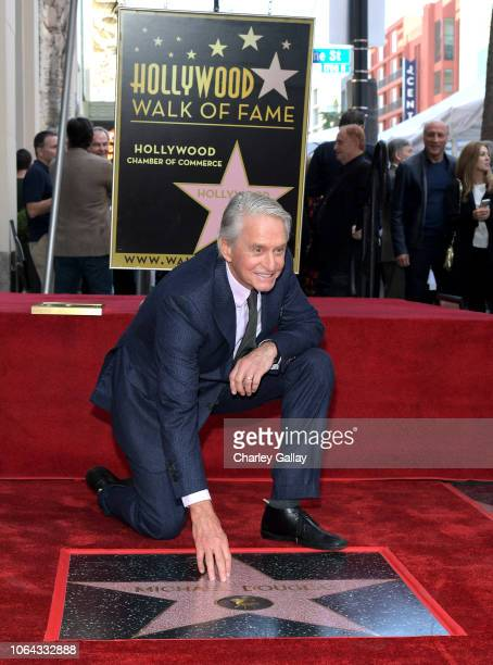 Michael Douglas poses with his star at the Hollywood Walk of Fame Ceremony Honoring Michael Douglas on Hollywood Boulevard on November 06 2018 in...