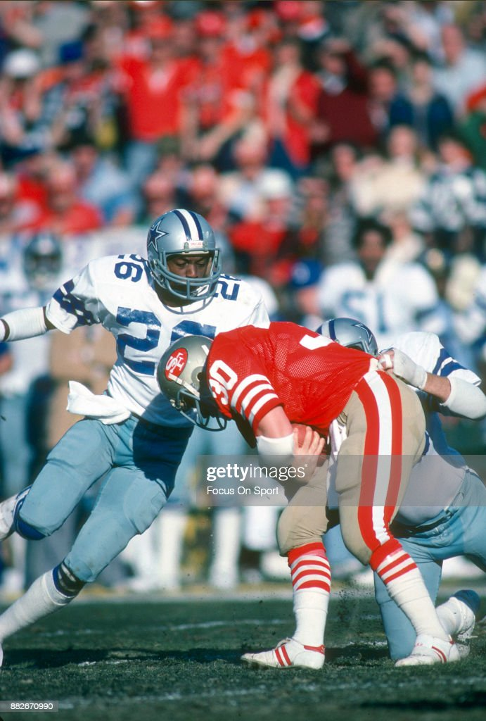 Michael Downs of the Dallas Cowboys tackles Bill Ring of the San Francisco 49ers during the NFC Conference Championship Game January 10 1982 at...