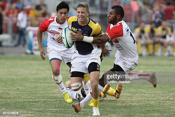 Michael Dowsett of The Brumbies charges forward during the World Club 10s match between The Brumbies and Biarritz Olympique at the National Stadium...