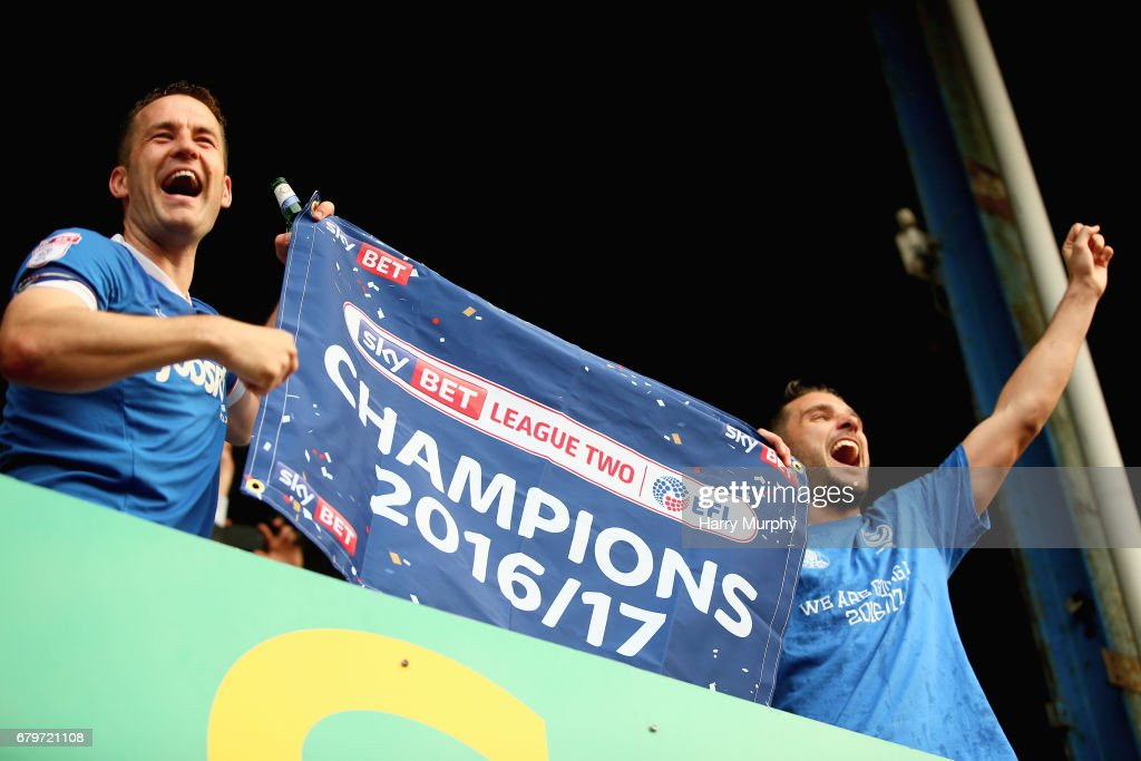 Michael Doyle and Gareth Evans celebrate being chmpions after the Sky Bet League Two match between Portsmouth and Cheltenham Town at Fratton Park on May 6, 2017 in Portsmouth, England.