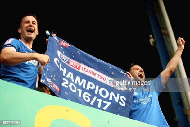 Michael Doyle and Gareth Evans celebrate being chmpions after the Sky Bet League Two match between Portsmouth and Cheltenham Town at Fratton Park on...