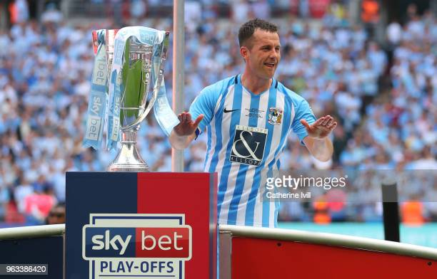 Michael Doyle of Coventry City celebrates with the trophy after the Sky Bet League Two Play Off Final between Coventry City and Exeter City at...
