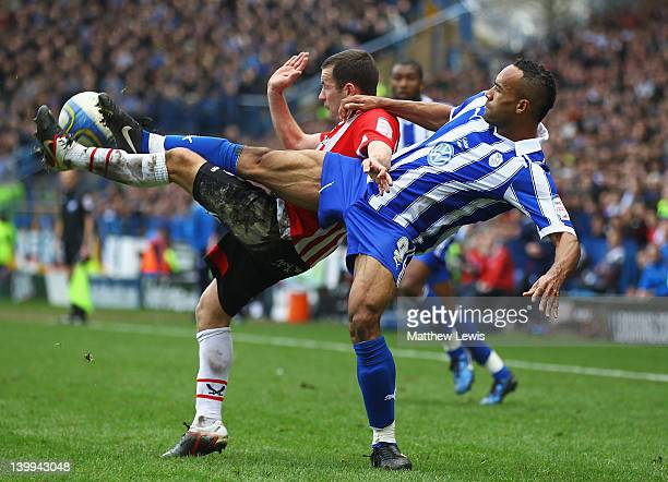 Michael Doyle of Sheffield United and Chris O'Grady of Sheffield Wednesday challenge for the ball during the npower League One match between...