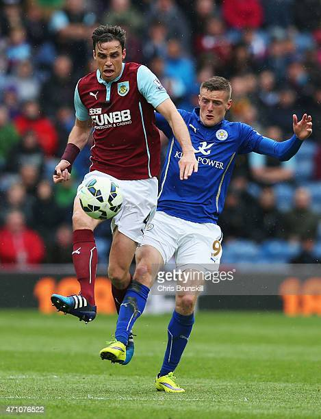 Michael Duff of Burnley and Jamie Vardy of Leicester City tussle for the ball during the Barclays Premier League match between Burnley and Leicester...