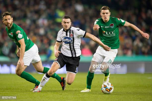Michael Duffy of Dundalk fights for the ball with Alan Bennett and Garry Buckley of Cork during the Irish Daily Mail FAI Senior Cup Final between...