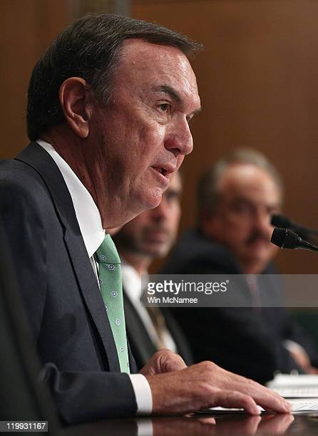 Michael Duke president and CEO of WalMart Stores Inc testifies before the Senate Finance Committee July 27 2011 in Washington DC The committee heard...