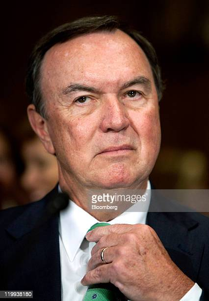Michael Duke, president and chief executive officer of Wal-Mart Stores, Inc., prepares to testify to the Senate Finance Committee in Washington,...