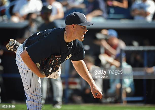 Michael Dunn of the New York Yankees delivers a pitch during a Grapefruit League Spring Training Game against the Minnesota Twins at George M....