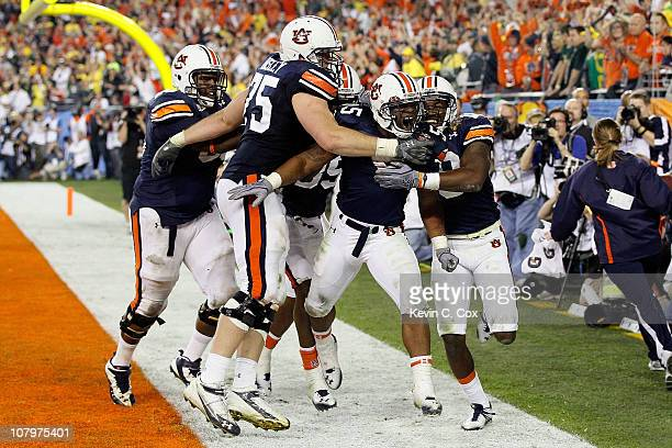 Michael Dyer of the Auburn Tigers celebrates with teammates after he runs the ball for 16-yards and is called down at the one-yardline with 10...