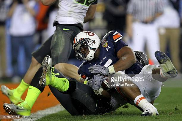 Michael Dyer of the Auburn Tigers runs the ball for 16-yards and is called down at the one-yardline with 10 seconds remaining in the fourth quarter...