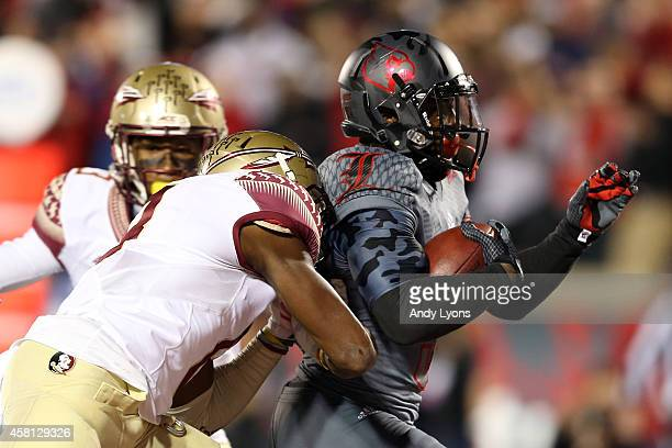 Michael Dyer of the Louisville Cardinals scores a touchdown in the second quarter against the Florida State Seminoles during their game at Papa...
