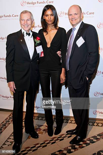 Michael E Novogratz founder and president of Fortress Investment Group LLC right supermodel Liya Kebede center and Rob Davis founder of Hedge Funds...