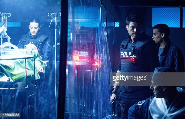 Michael Ealy and Karl Urban in the 'Arrhythmia' episode of ALMOST HUMAN airing Monday Dec 16 2013 on FOX