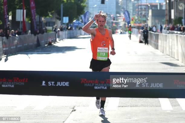 Michael Eaton crosses the finish line to win the Men's 1/2 Marathon during the St Jude Rock 'n' Roll Seattle Marathon 1/2 Marathon on June 10 2018 in...