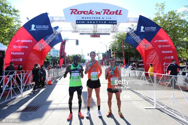 Michael Eaton Jonathan Lafler and Roosevelt Cook stand at the finish line after finishing as the top three in the Men's 1/2 Marathon during the St...