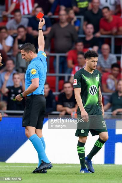 Michael Edwards of VfL Wolfsburg gets the red card during the pre-season friendly match between PSV Eindhoven and WfL Wolfsburg at Philips Stadion on...