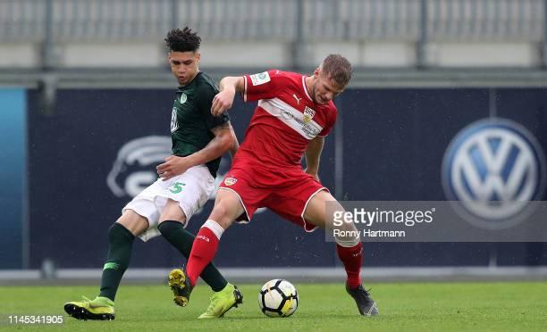 Michael Edwards of Wolfsburg and Eric Hottmann of Stuttgart compete during the U19 German Championship Semi Final second leg match between VfL...
