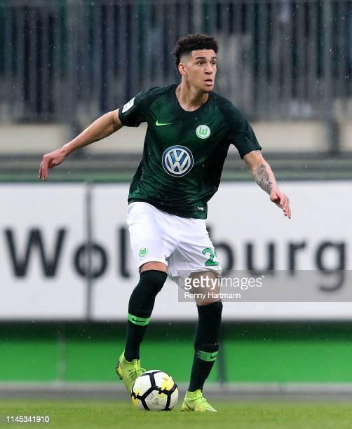 Michael Edwards of Wolfsburg runs with the ball during the U19 German Championship Semi Final second leg match between VfL Wolfsburg U19 and VfB...