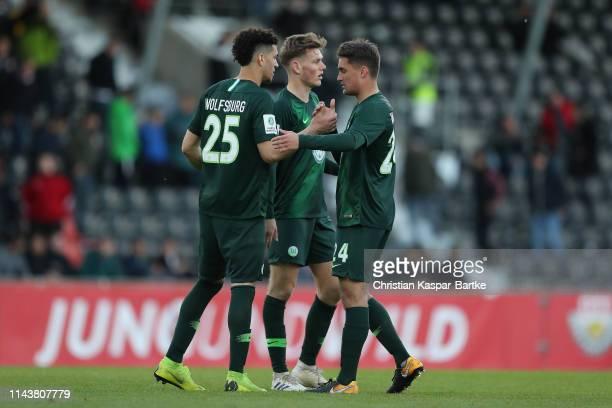 Michael Edwards, Tim Siersleben and Luis Manuel Saul of VfL Wolfsburg celebrate after the A-Juniors German Championship Semi Final Leg One between...