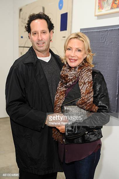 Michael Eisenberg and Laurie Eisenberg attend The Rema Hort Mann Foundation LA Artist Initiative Benefit Auction on November 21 2013 in Los Angeles...