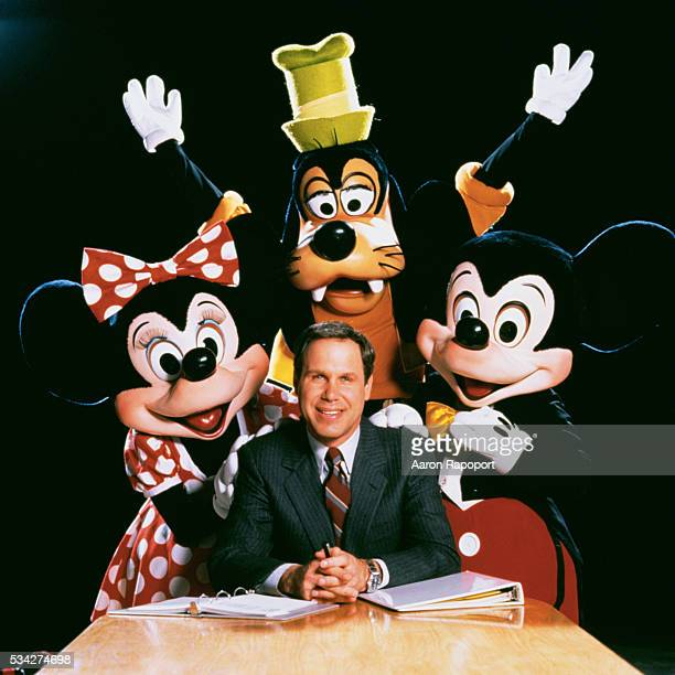 Michael Eisner with Minnie Mouse Mickey Mouse and Pluto