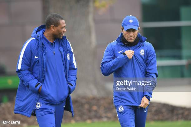 Michael Emenalo and Antonio Conte of Chelsea during a training session at Chelsea Training Ground on September 26 2017 in Cobham England
