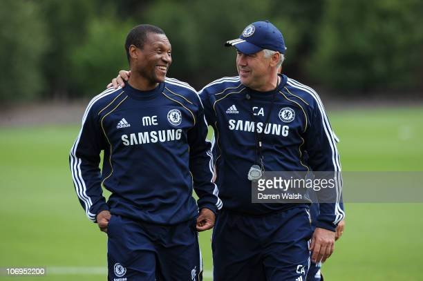 Michael Emenalo and Carlo Ancelotti of Chelsea during a training session at the Cobham training ground on July 30 2010 in Cobham England
