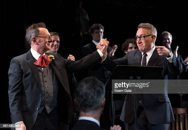 Michael Emerson and Moises Kaufman are seen onstage during the 'Gross Indecency The Three Trials Of Oscar Wilde' curtain call at Gerald W Lynch...