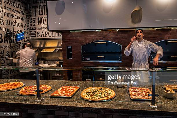 Michael Englese of Zizi's Pizza tosses his dough at the National Market in the new MGM National Harbor Casino preparing to open next week on December...