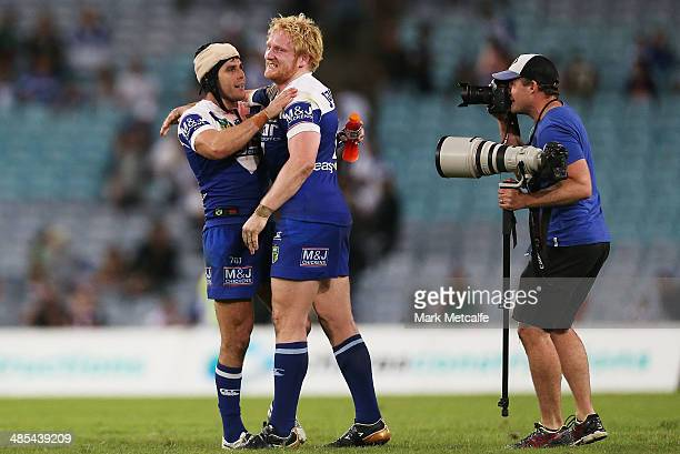Michael Ennis and James Graham of the Bulldogs celebrate victory in the round seven NRL match between the South Sydney Rabbitohs and the...