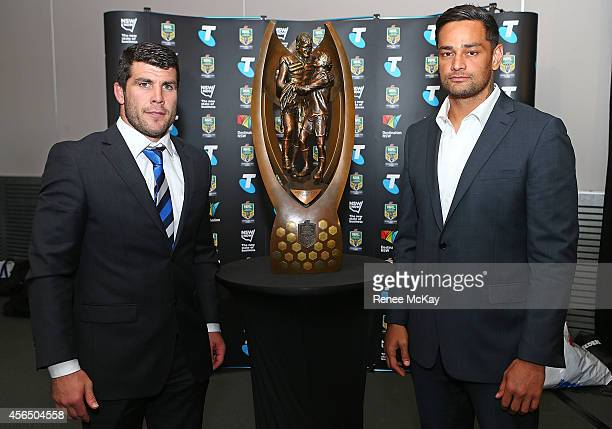 Michael Ennis and John Sutton pose with the trophy during a press conference at the 2014 NRL Grand Final lunch at The Star on October 2 2014 in...
