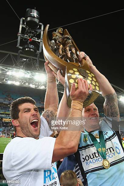 Michael Ennis and Luke Lewis of the Sharks celebrate with the trophy after voctiry during the 2016 NRL Grand Final match between the Cronulla Sharks...
