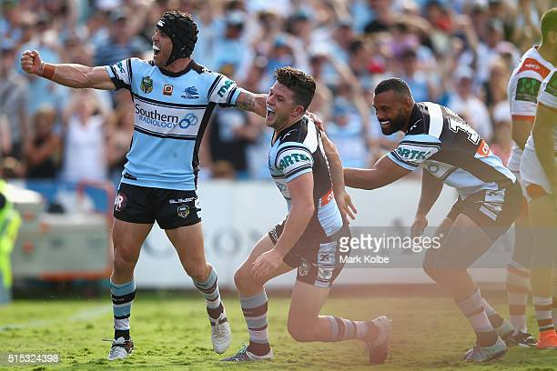 Michael Ennis Chad Townsend and Jayson Bukuya of the Sharks celebrate Townsend scoring a try during the round two NRL match between the Cronulla...