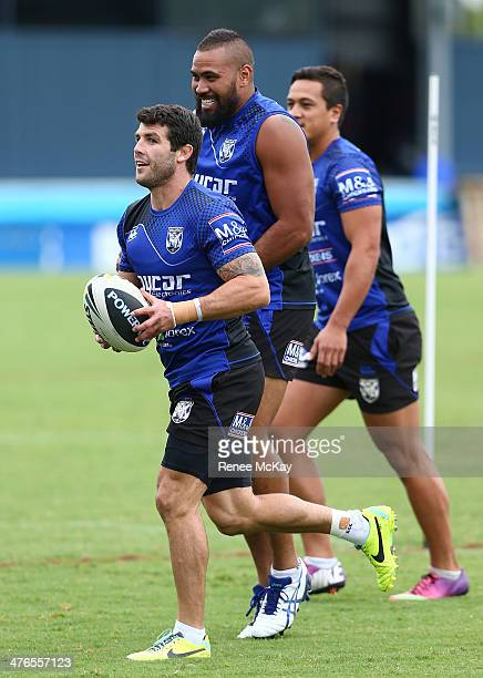 Michael Ennis, Frank Pritchard and Chase Stanley look on during a Canterbury Bulldogs NRL training session at Belmore Sports Ground on March 4, 2014...