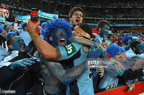 Michael Ennis of the Blues celebrates with fans after winning game two of the ARL State of Origin series between the New South Wales Blues and the...