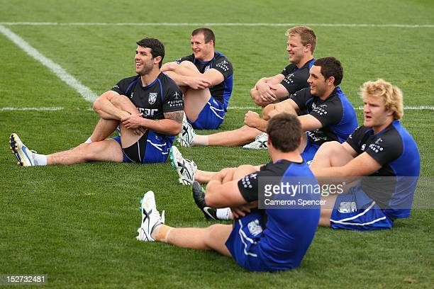 Michael Ennis of the Bulldogs and team mates stretch during a Canterbury Bulldogs NRL training session at Belmore Sports Ground on September 25 2012...