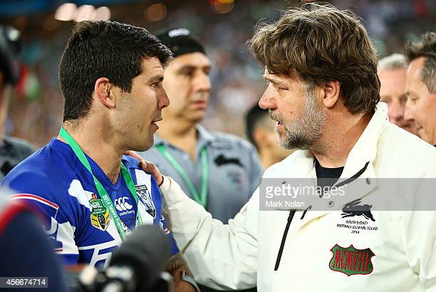 Michael Ennis of the Bulldogs chats with Russell Crowe after the Rabbitohs won the 2014 NRL Grand Final match between the South Sydney Rabbitohs and...