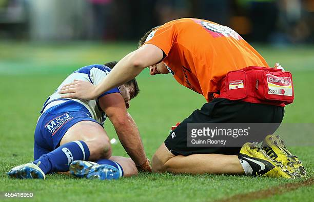Michael Ennis of the Bulldogs is attened to by a trainer during the NRL 2nd Elimination Final match between the Melbourne Storm and the Canterbury...