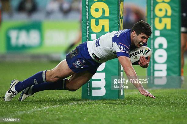 Michael Ennis of the Bulldogs scores a try during the round 24 NRL match between the Canterbury Bulldogs and the Wests Tigers at ANZ Stadium on...