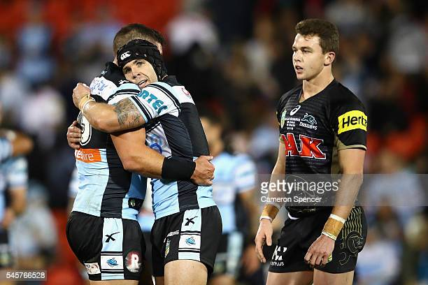 Michael Ennis of the Sharks and Chris Heighington of the Sharks embrace after winning the round 18 NRL match between the Penrith Panthers and the...