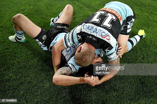 Michael Ennis of the Sharks and Luke Lewis of the Sharks celebrate winning the 2016 NRL Grand Final match between the Cronulla Sharks and the...