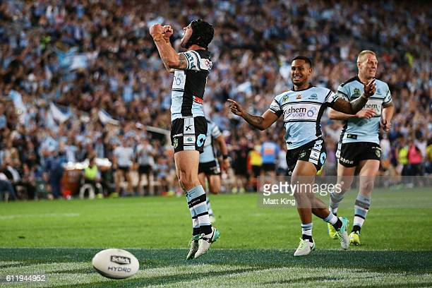 Michael Ennis of the Sharks celebrates the try to Andrew Fifita of the Sharks during the 2016 NRL Grand Final match between the Cronulla Sharks and...
