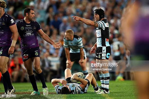 Michael Ennis of the Sharks gestures to Cameron Smith of the Storm during the 2016 NRL Grand Final match between the Cronulla Sharks and the...
