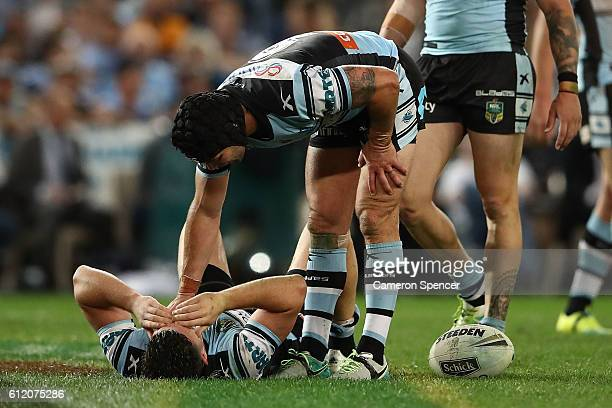 Michael Ennis of the Sharks reacts as Chad Townsend of the Sharks lays on the field after a tackle during the 2016 NRL Grand Final match between the...