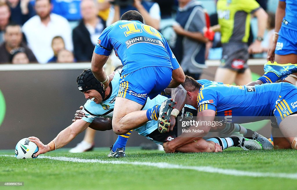 Michael Ennis of the Sharks scores the winning try during the round 25 NRL match between the Parramatta Eels and the Cronulla Sharks at Pirtek Stadium on August 29, 2015 in Sydney, Australia.