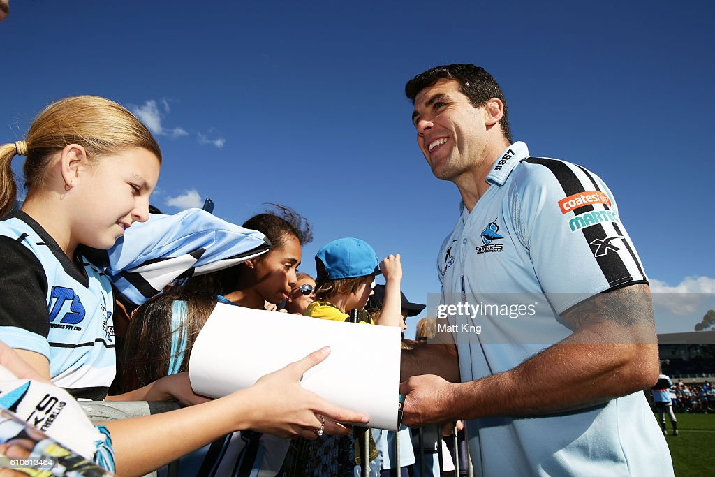 Michael Ennis of the Sharks signs autographs for fans during a Cronulla Sharks NRL fan day at Southern Cross Group Stadium on September 27, 2016 in Sydney, Australia.